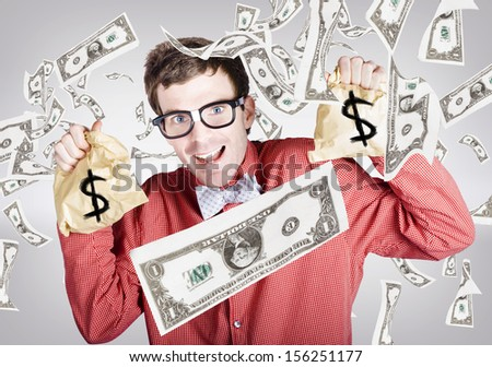 Happy accountant man enjoying the rain of falling money while holding tax return money bags.  Business success concept - stock photo