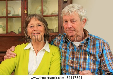Happy active retired man and woman in their seventies. - stock photo