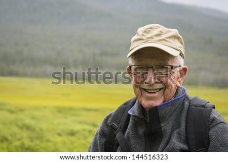 Happy active senior man enjoying the outdoors - stock photo