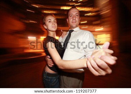Happy adult couple dancing tango in night New York city - stock photo