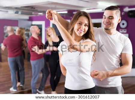 Happy adult couples enjoying of partner dance indoor - stock photo