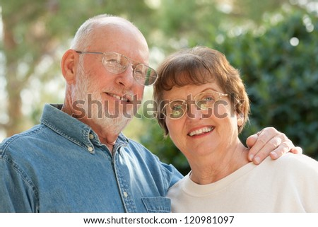 Happy Affectionate Smiling Senior Couple Outdoor Portrait - stock photo