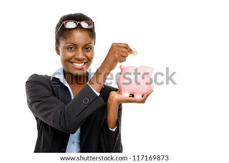 Happy African American business woman holding piggybank isolated on white background - stock photo