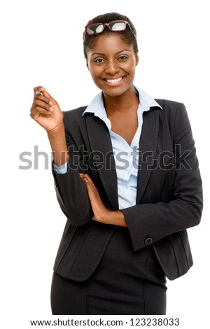 Happy African American businesswoman holding pen white background - stock photo