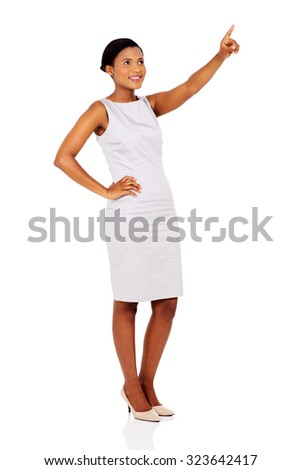 happy african american businesswoman pointing empty space isolated on white background - stock photo