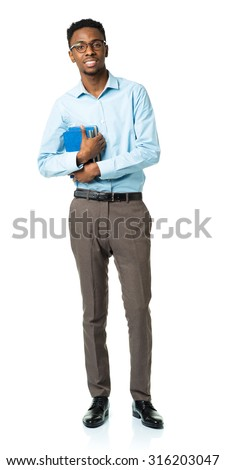 Happy african american college student standing with books in his hands on white background - stock photo