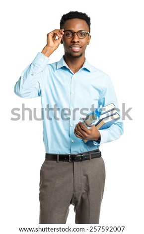 Happy african american college student with books and bottle of water in his hands  standing on white background - stock photo