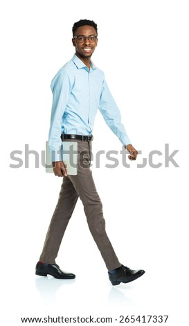 Happy african american college student with laptop standing on white background - stock photo