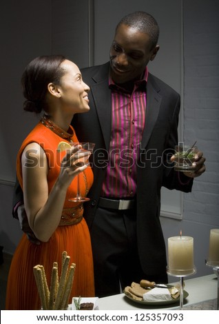 Happy african american couple at a party - stock photo