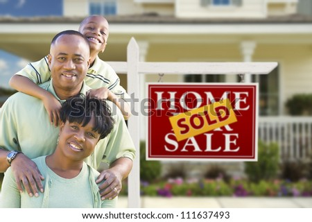 Happy African American Family In Front of Sold Real Estate Sign and House. - stock photo