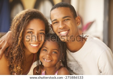 Happy african american family smiling - stock photo