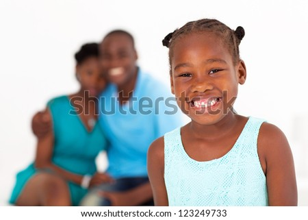 happy african american little girl standing in front of parents - stock photo