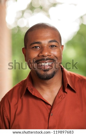 Happy African American man smiling - stock photo