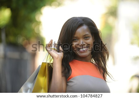 happy african american with shopping bags - stock photo