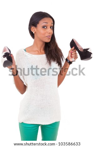 Happy  african american woman holding a high heel shoe in her hands - stock photo