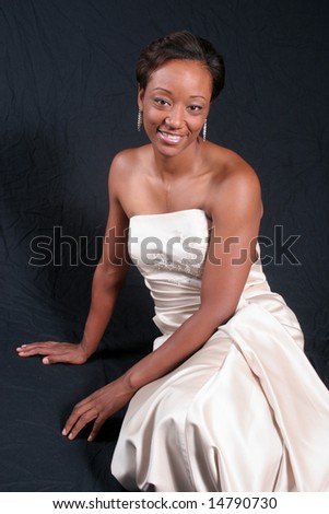 Happy African American woman relaxing with a happy smile - stock photo