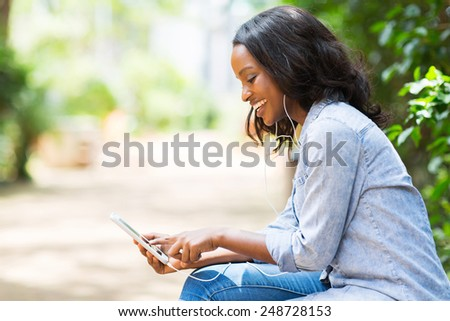 happy african american woman with smart phone listening music - stock photo