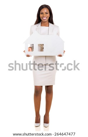 happy african business woman holding house symbol on white background - stock photo