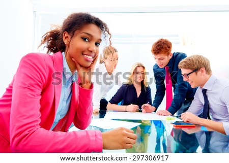 happy african businesswoman gesture in multi ethnic teamwork meeting at office - stock photo