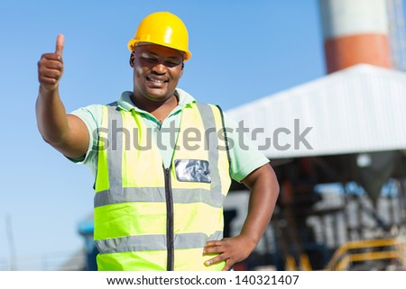 happy african construction worker giving thumb up - stock photo
