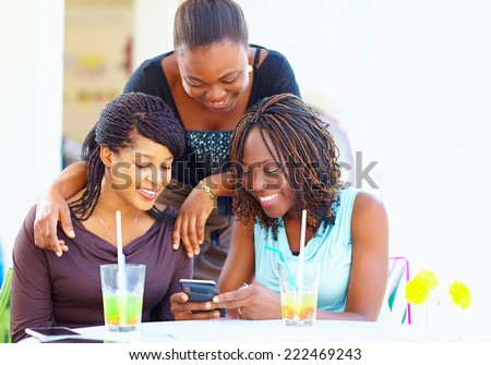happy african friends chatting in social network - stock photo