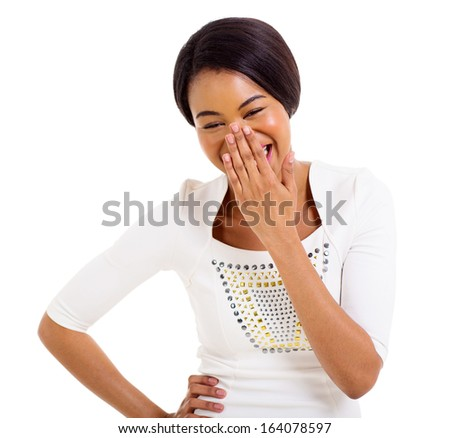 happy african woman covering her mouth and laughing isolated on white background - stock photo
