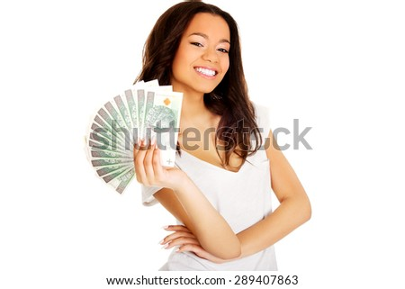 Happy african woman holding polish money. - stock photo