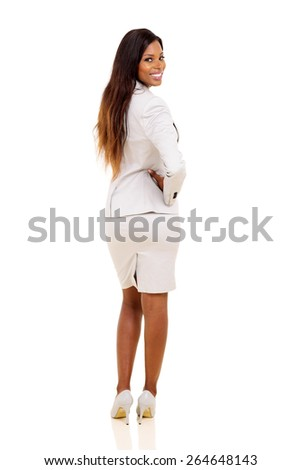 happy african woman looking back on white background - stock photo