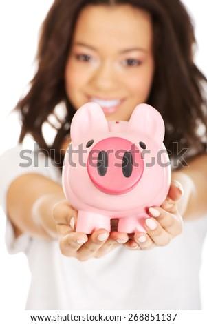 Happy african woman with piggybank. - stock photo