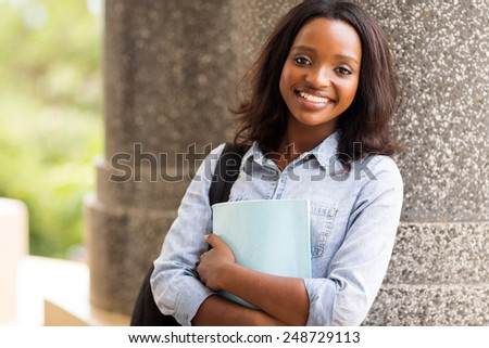 happy afro american university student looking at the camera - stock photo