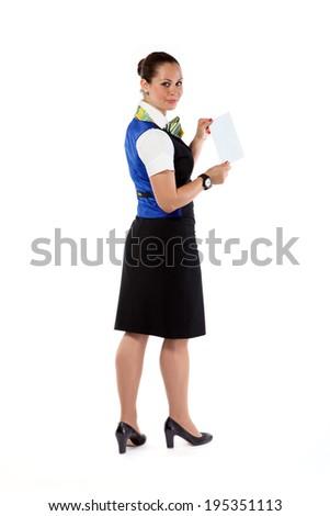 Happy air hostess holding ticket - stock photo