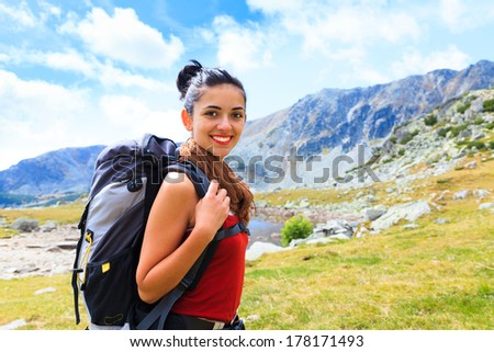 Happy alpinist enjoying the hiking in the mountains. - stock photo