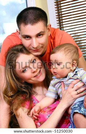 happy and beautiful family with kid - stock photo