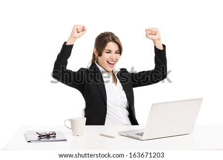 Happy and beautiful hispanic business woman in the office with arms up, isolated over a white background - stock photo