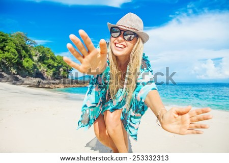 happy and beautiful young woman on a beach of bali, indonesia - stock photo