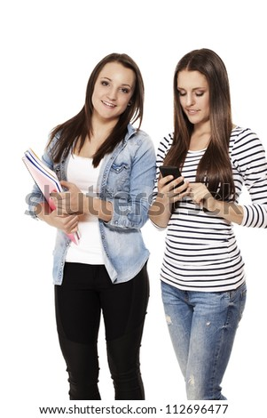 happy and busy students with smartphone and exercising books on white background - stock photo