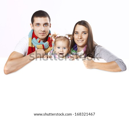 Happy and cheerful family pose on a blank on the banner - stock photo