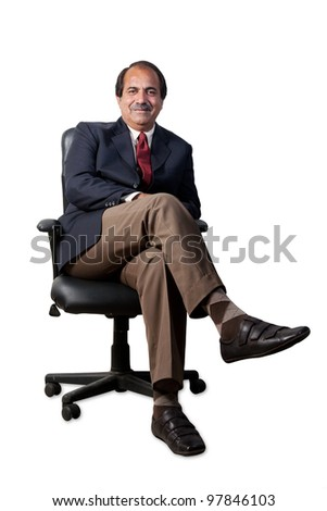 happy and confident senior businessman sitting in the office chair isolated on white background, mature businessman sitting in office chair - stock photo