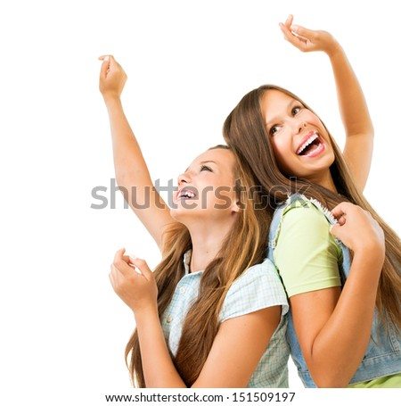 Happy and Laughing Teenage Girls Dancing. Hands up. Beauty Teenagers Having Fun together. Girlfriends - stock photo