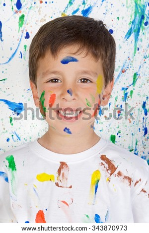 Happy and painted child stained paint - stock photo