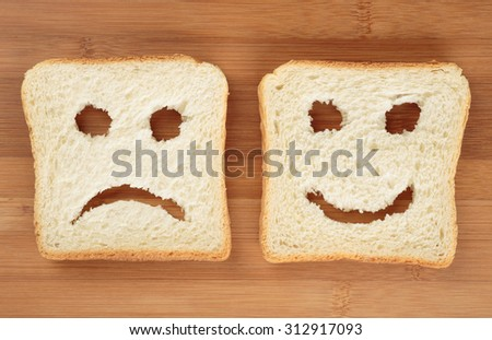 Happy and sad on a cutting board - stock photo