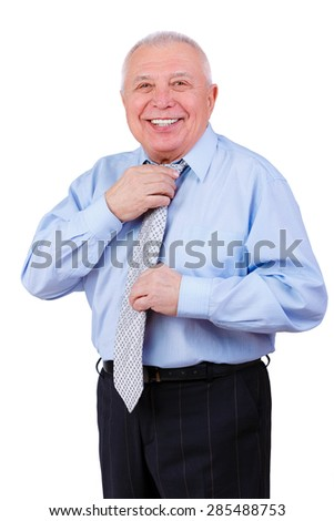 Happy and smile old mature businessman with white smile straightens his tie. isolated on white background. Positive human emotion, facial expression - stock photo
