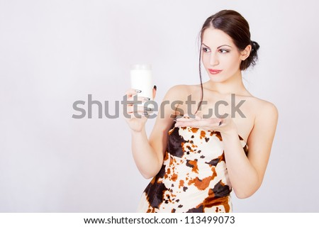 happy and smiling beautiful young woman enjoying a glass milk - stock photo