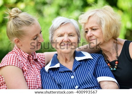 Happy and smiling family. Three generations of women. MANY OTHER PHOTOS FROM THIS SERIES IN MY PORTFOLIO. - stock photo