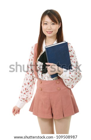 happy and smiling young asian woman with book - stock photo