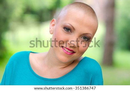 Happy and young cancer survivor after successful chemotherapy. - stock photo