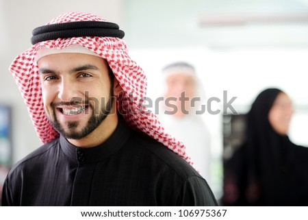 Happy Arabic man at work smiling - stock photo