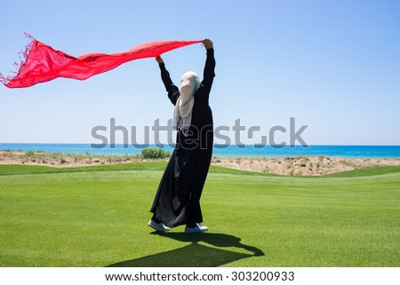 Happy Arabic Muslim girl in beautiful nature - stock photo