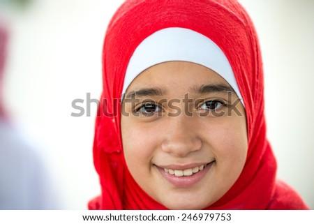Happy Arabic Muslim Middle Eastern girl - stock photo