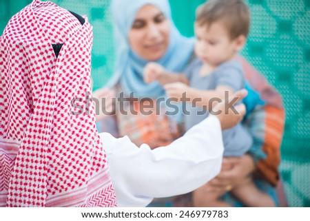 Happy Arabic Muslim Middle Eastern Gulf family - stock photo